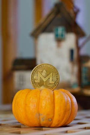 Digital currency physical metal monero coin. Cryptocurrency halloween concept. Publikacyjne