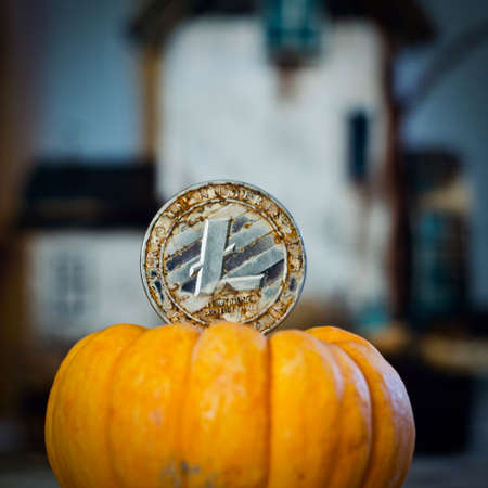 Digital currency physical metal litecoin coin. Cryptocurrency halloween concept. Publikacyjne