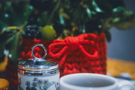 Beautiful wool handmade decoration. Knitting and crochet. Handmade crocheting crafts. DIY. Zdjęcie Seryjne - 137174722