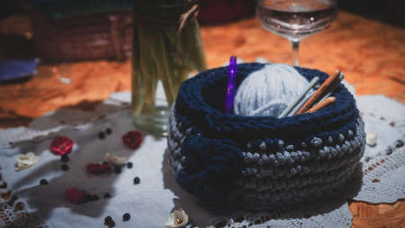 Beautiful wool handmade decoration. Knitting and crochet. Handmade crocheting crafts. DIY. Zdjęcie Seryjne - 137174886
