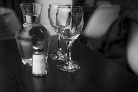 Carafe of water and two glasses.  Indoor shot using natural light. photo