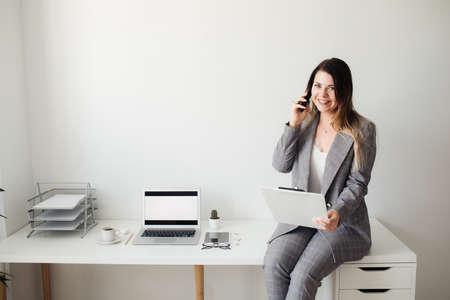 younger girl working in the office at the table