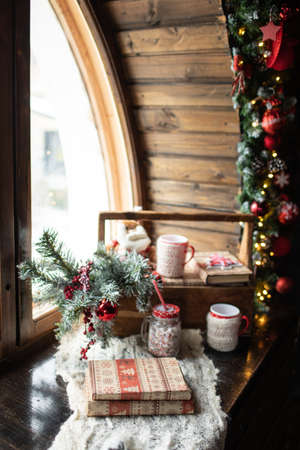Christmas composition, on the window is the branches of the Christmas tree, Christmas toys, Santa Claus. New Year