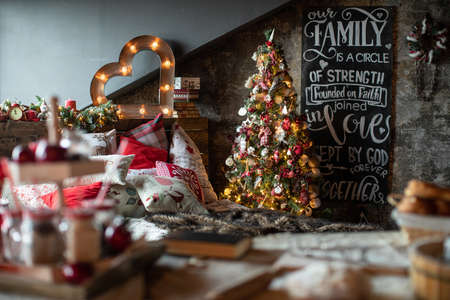 Christmas tree in a beautifully decorated house with Christmas gifts under it