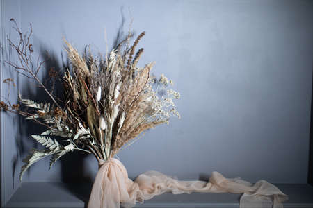 Beautiful autumn bouquet of mixed branches. The job of a florist Stock Photo