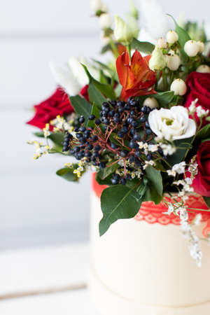 Beautiful bouquet of mixed flowers with peonies. The work of the florist. Flower delivery Banque d'images