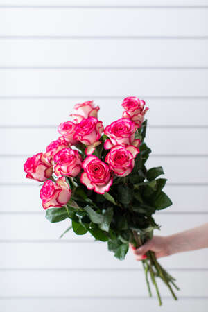 Beautiful bouquet of mixed flowers with roses. The work of the florist. Flower delivery.