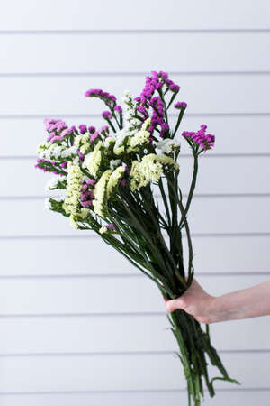 Beautiful bouquet of beautiful flowers. The work of the florist. Flower delivery. 免版税图像