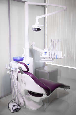 Workplace of dentist with dental unit and chair.