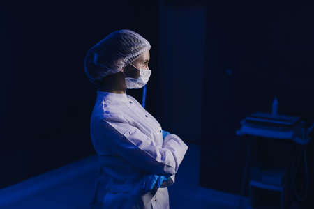 Portrait of Young Female Doctor in Medical Mask.