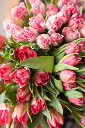Close-up Large Beautiful bouquet of mixed tulips. Flower background and Wallpaper. Floral shop concept . Beautiful fresh cut bouquet. Flowers delivery.