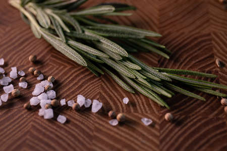 Close-up of thyme on a wooden Board with spices. Restaurant menu, a series of photos of various dishes Zdjęcie Seryjne