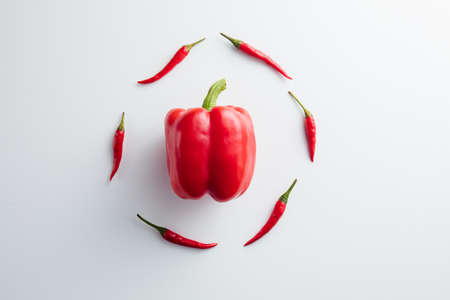 Red pepper on a white background. Minimum concept