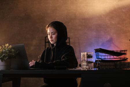 Asian girl freelancer working on a laptop