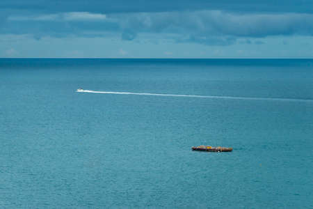Atlantic Ocean at Recife in Brazil with fishing platform and speedboat