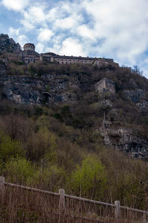 View of the fortress of Anfo from the town of the same name, with a tourist and fishing port, a tourist destination for holidays at the lake, at the foot of the Alps immersed in unspoilt nature.