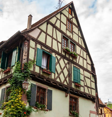 Riquewihr in Alsace, France. Enchanting medieval village, along the Strada dei Vini that connects Colmar to Strasbourg. View of the old village within the walls.