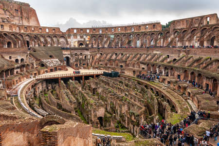 Rome Italy. Interior of the Colosseum, famous for its shows with gladiators in the Roman Empire. View of the stands for the spectators and the underground rooms, from where lions and tigers came out. Stock Photo