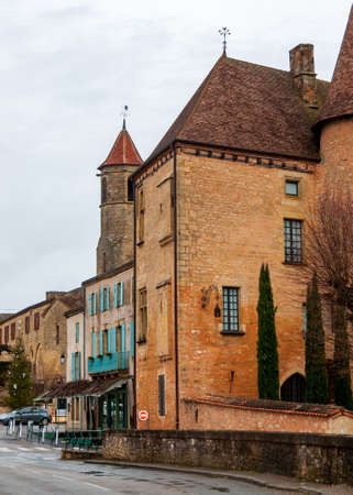 Belves, in the Dordogne-Périgord region in Aquitaine, France. Medieval village with typical houses perched on the hill, among pastures and green countryside.