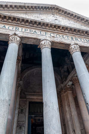 """Rome Italy. Detail of the facade of the Pantheon, a majestic temple of the Roman Empire. The Latin inscription remembers the builder """"Marco Agrippa, son of Lucio, consul for the third time, he built"""""""