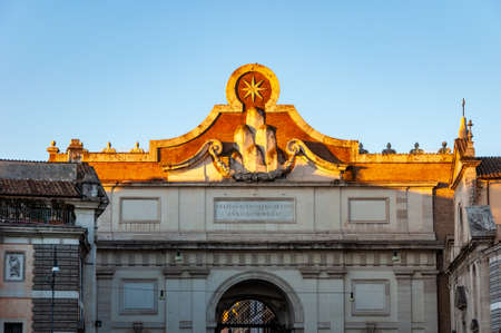 """Rome Italy. Internal facade of """"Porta del Popolo"""", in the square of the same name, work by Bernini. The Latin inscription says """"For a happy and auspicious entrance in the year 1655""""."""