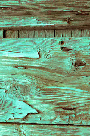 Wooden panels and planks of rural house door, Italy. Walls and ornaments in painted wood for the country house, ruined by time. Stock fotó