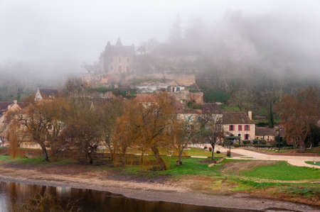 Limeuil, in the Dordogne-Périgord region in Aquitaine, France. Medieval village with typical houses perched on the hill, overlooking the confluence of the Dordogne and Vézère rivers.