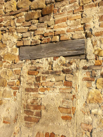 Typical detail of an ancient Italian house wall, made of hand-carved river stones. Wall with which rural houses were built in the 20th century in the Po valley