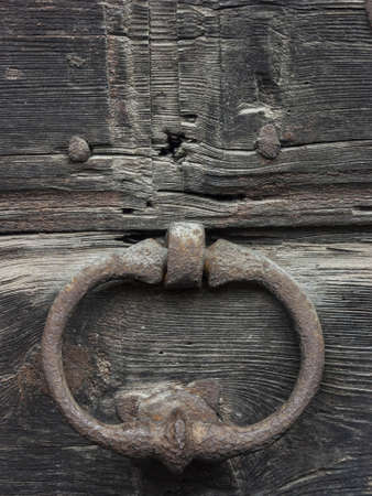 Antique door with wooden plank panels of a rural house, with iron fixing parts, Italy. Stock fotó