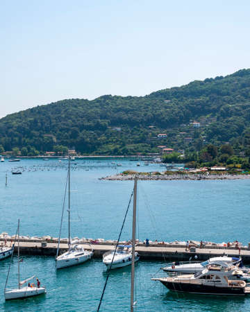 Portovenere, Italy. Beautiful seaside village with the famous gulf of poets that inspired the poems of Byron, a popular tourist destination for beach holidays and tracking in unspoiled nature. Tourist port.