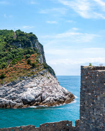 Portovenere, Italy. Beautiful seaside village with the famous gulf of poets that inspired the poems of Byron, a popular tourist destination for beach holidays and tracking in unspoiled nature. Church of San Pietro and Island of Palmaria.