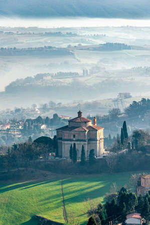 """Todi in Umbria, Italy. Panorama from the medieval city of the Church of the """"SS. Crocifisso"""" and of the valley of the Tiber river, which flows towards Orvieto and Rome."""