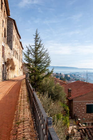 Todi in Umbria, Italy. View of the ancient village full of medieval buildings. It rises on the hills since the Etruscan times and overlooks the valley of the Tiber river. Archivio Fotografico