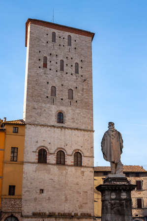 """Todi in Umbria, Italy. View of the """"Palazzo dei Priori"""" in the ancient medieval village. It rises on the hills since the Etruscan times and overlooks the valley of the Tiber river."""