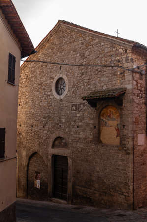 Todi in Umbria, Italy. View of the ancient village full of medieval buildings. It rises on the hills since the Etruscan times and overlooks the valley of the Tiber river.