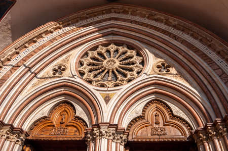 Assisi, the city of peace, Italy. the birthplace of San Francesco. View of the portal on the facade of the lower Basilica dedicated to the saint.