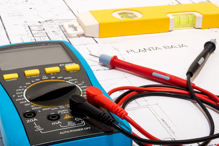 multimeter tester placed on a plane