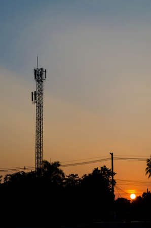 telecommunications tower in fields on sunset photo