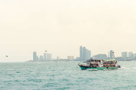 ferryboat: wooden ferryboat in Pattaya harbor at Thailand Editorial