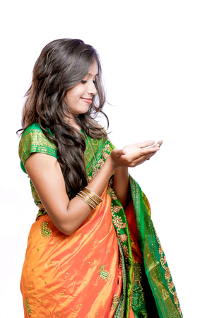 Happy young beautiful traditional Indian woman in traditional saree Stock Photo - 84915119