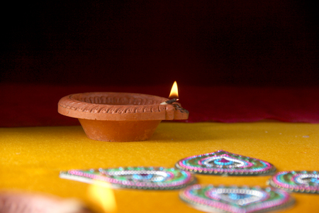 Rangoli design around Diwali lamp Stock Photo