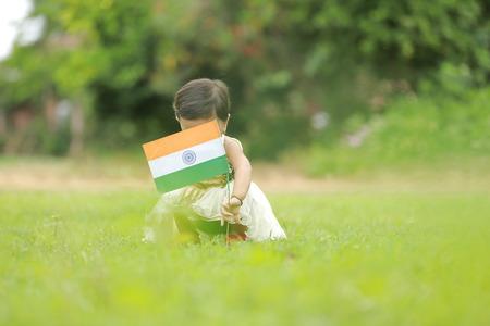 indian girl child holding indian flag Stock Photo