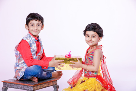 cute Indian child brother and sister celebrating raksha bandhan festival Stock Photo