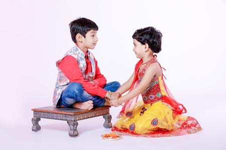 cute Indian child brother and sister celebrating raksha bandhan festival Stock Photo