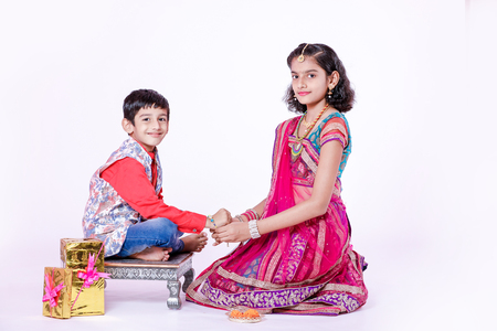 Cute Indian child brother and sister celebrating Raksha Bandhan festival