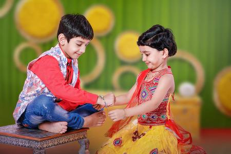 cute Indian brother and sister celebrating raksha bandhan festival