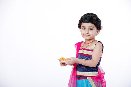 A cute, little Indian girl wearing a traditional costume Stock Photo