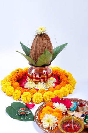 Copper Kalash with coconut , leaf and floral decoration on a white background. essential in hindu puja. Banco de Imagens