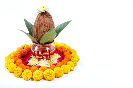 Copper Kalash with coconut , leaf and floral decoration on a white background. essential in hindu puja. Stock Photo