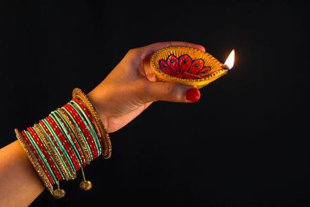 Indian Festival diwali , Lamp in hand Stockfoto